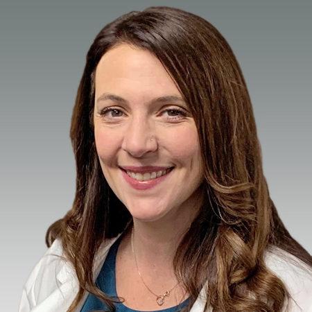 Katy Fryer in white coat smiling