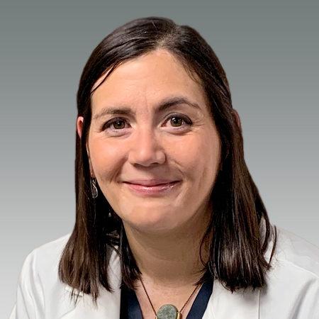 Sarena Sunico in white coat smiling